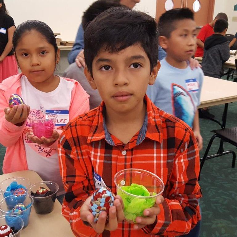 Kids holding Easter eggs